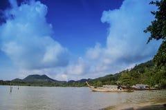 Thai boats in a paradise beach Stock Photos