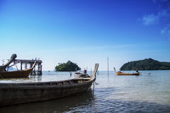 Thai boats in a paradise beach Royalty Free Stock Images