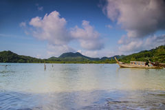 Thai boats in a paradise beach Royalty Free Stock Photography