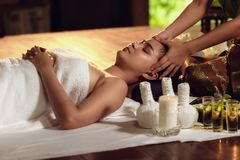 Free Thai Body Spa Massage With Aroma Herbs., Pretty Attractive Asian Woman Is Relaxing By Beauty Skin Care After Traveling In Thailand Stock Image - 139144811