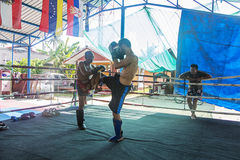 Thai boxers. Unidentified Thai boxers fighting in the ring. Muay Thai is a Thailand combat sport that uses stand-up striking with various clinching techniques Royalty Free Stock Photos
