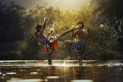 Thai boxing. The fighter tying tape around his hand preparing to fight,Thai boxing at the river,Boxing fighters trainning outdoor,Muay Thai Stock Photography