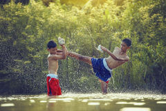 Thai boxing. The fighter tying tape around his hand preparing to fight,Thai boxing at the river,boxing and fighting to protect Stock Photo