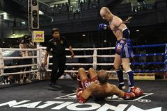 Thai Boxing Match. Unidentified athletes compete in the World Amateur Muay Thai Championships at the National Stadium on March 22, 2012 in Bangkok, Thailand Stock Photos
