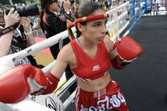Thai Boxing Match. A female Muay Thai fighter warms up before a match in the World Amateur Muay Thai Championships at the National Stadium on March 23, 2012 in Royalty Free Stock Image