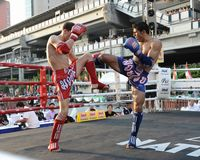 Thai Boxing Match. Muay Thai fighters compete in a match in the World Amateur Muay Thai Championships at the National Stadium on March 20, 2012 in Bangkok Royalty Free Stock Images