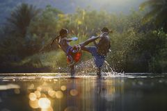 Thai boxing at the river stock photography