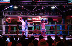 Thai boxing show to tourists in night bar Royalty Free Stock Image
