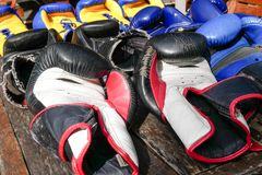 Thai boxing used gloves, muay thai gear. Second hand boxing equipment Royalty Free Stock Image