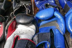 Thai boxing used gloves, muay thai gear. Second hand boxing equipment Royalty Free Stock Photo