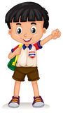 Thai boy carrying a backpack Royalty Free Stock Image