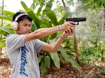 Thai boy shooting pistols Stock Image