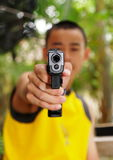 Thai boy shooting pistols Stock Photography