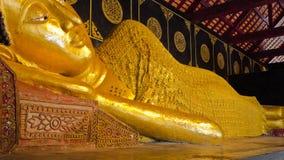 Thai Buddha Statue. Reclining Buddha image at Wat Thai in Chiangmai Royalty Free Stock Photography