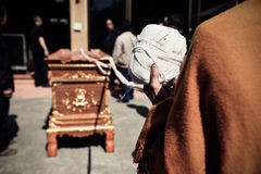 Thai buddhism monk religious prayingl for the cremation. The cor. Pse in the coffin prepared for burning in the cremate royalty free stock image