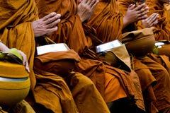 Thai Buddhism monks pray. Hand of Thai Buddhism monks pray Royalty Free Stock Photo