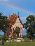 Thai Buddhist church of Nong Puen Taek Temple. Buddhism church with rainbow background. It is a temple in country side, on the way to Kaengkrachan national stock image