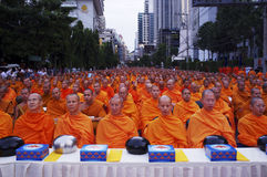 Bangkok, Thailand, Buddhist Monks in Prayer in Asoke. Thai Buddhist monks pray in Bangkok to celebrate the 2600th anniversary of the Buddha's enlightenment Royalty Free Stock Photos