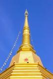 Thai Buddhist pagoda with blue sky background Royalty Free Stock Image