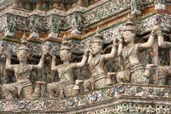 Thai buddhist sculpture. Buddhist sculpture on wat arun temple wall, bangkok, thailand Stock Image