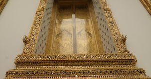 Thai buddhist temple. In bangkok wat suthat windiw gold stock video footage