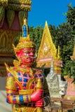 Thai Buddhist Temple Guard. Thai Buddhist Temple stone Guardian Giant Suriyaphob, mythological guard statue in Thailand wat. Ancient mythological mythical magic royalty free stock image