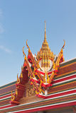 Thai Buddhist temple roof gable with tiered and carved apex Stock Photos