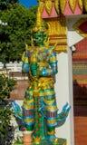 Thai Buddhist Temple Guard. Thai Buddhist Temple stone Guardian Giant Suriyaphob, mythological guard statue in Thailand wat. Ancient mythological mythical magic stock images