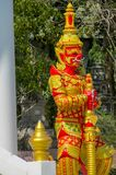Buddhist Temple Guard in Thailand wat. Thai Buddhist Temple stone Guardian Giant Suriyaphob, mythological guard statue in Thailand wat. Ancient mythological stock photography