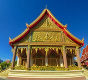 Thai buddhist temple wat with rich decoration. Thai buddhist temple wat in Thailand beautiful decorated with high towers. Pagoda with rich decoration Royalty Free Stock Photo