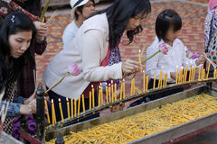 Thai Buddhists. Thailand, Chiang Mai, Thai Buddhists light candles at Wat Doi Suthep royalty free stock images