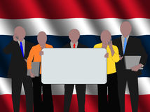 Thai business team with flag Royalty Free Stock Photos