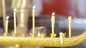 Thai candle stand and smoke, panning left stock video footage