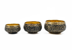 Thai carving brass in different size  on w Stock Photos