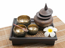 Thai carving brass and wooden bowl in wooden tray Royalty Free Stock Photo