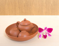 Thai Ceramic Tea Set with Orchid Flower. Thai Ceramic Tea Set with Two Cups Placed on a Wooden Table with Orchid Flower Stock Photos