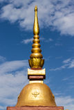 Thai chedi over blue sky Royalty Free Stock Photo