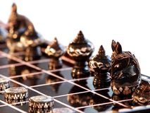 THAI chess as home decorate elements. Old antique Thai chess figures with fine artistic ornamental typical thai graphics and arts showing on the small sculpture Stock Photography