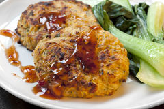 Thai Chicken Burgers with Sweet Chili Sauce and Asian Greens Royalty Free Stock Photography