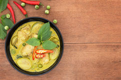 Thai chicken green curry with old wooden background. Thai food Stock Photos