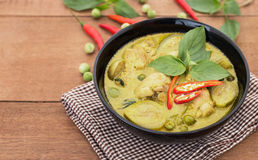 Thai chicken green curry with old wooden background. Thai food Royalty Free Stock Photography