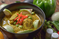 Thai chicken green curry with old wooden table Stock Photos