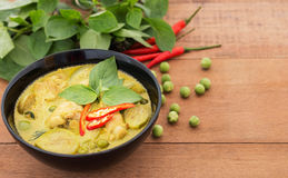 Thai chicken green curry, Thai food. Thai chicken green curry with old wooden background Stock Photo