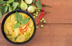 Thai chicken green curry , Thai food. Thai chicken green curry with old wooden background Stock Photo