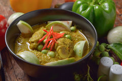 Thai chicken green curry with  wooden background Stock Photos