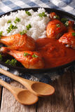 Thai Chicken legs baked in spicy chilli sauce Sriracha and Rice Stock Photo