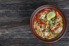 Thai Chicken noodle soup in clay bowl stock image