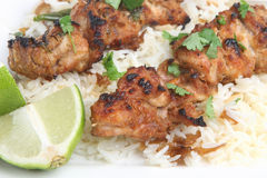 Thai Chicken Satay. S on a bed on coconut rice Royalty Free Stock Image