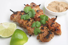 Thai Chicken Satays. Thai marinated chicken skewers with peanut sauce dip and lime Stock Images
