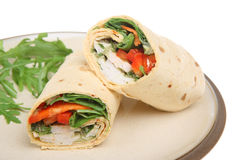 Thai Chicken Wrap. Thai-spiced chicken in a soft tortilla wrap Royalty Free Stock Images